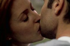 Mulder and Scully kiss in Millenium
