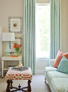 living rooms - Kelly Wearstler Imperial Trellis Fabric - Mandarin blue floral drapes turquoise blue lamp orange turquoise blue pillow tan walls white table