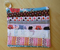 Stripping Is Hot Pad Tutorial - Use fabric scrap strips to make coasters that will happily hold your hot dishes for potlucks galore.