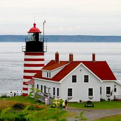 West Quoddy Head Lighthouse Lubeck, Maine The West Quoddy Head Lighthouse was the country's first to use bells as a fog-signal device. The easternmost lighthouse in the United States, the original structure was commissioned by Thomas Jefferson and built i Maine Lighthouses, Lighthouse Pictures, Beacon Of Light, Light Of The World, Am Meer, Le Moulin, Day Trips, New England, Places To Go