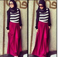 Upper body b&w stripes. Burgundy skirt.