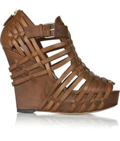 If I saw these walk by me, I would whistle and stare like a New York City construction worker. These brown woven babies are superb. The little straps sit on a stacked super high platform. I absolutely love how the straps don't stop at the platform, but come all the way over it bringing together … Continue reading Givenchy Woven Leather Wedges: Straps, Wedges and Zippers, Oh My!