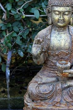 The Buddha with his hand in the teaching mudra