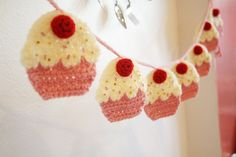 My kitchen needs this garland.  Here is the tutorial - http://www.rocknrollbride.com/2011/03/how-to-crochet-your-own-cupcake-garland-diy-tutorial-by-twinkie-chan-giveaway/