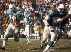 From 1970 through the Dolphins dropped the sleeve stripes from their aqua jerseys. Nfl Football Players, Football Memes, Basketball Players, Derek Carr Raiders, 1972 Miami Dolphins, Rodgers Packers, Nfl Uniforms, Nfl History, Football Photos