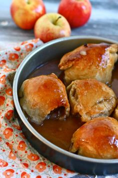 "Old fashioned ""Apple"" Dumplings  (or Peach)  ~~  The sauce bakes right along with the apples and turns into a magical caramel syrup that I was tempted to suck through a straw post baking. The dumplings themselves have the perfect combination of crispy and chewy corners of crust….so good that they will make a dumpling believer out of just about anyone."