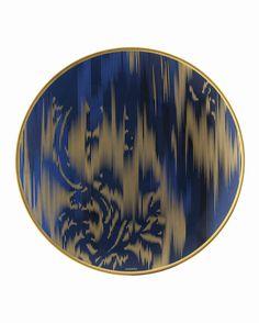 Voyage en Ikat new tableware from Hermes. Dark blue and gold pattern porcelain plate.