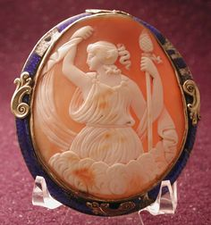 CAMEO OF ARIADNE OR DIONYSUS.The frame is enameled but does have 4 places of enamel loss.The size is 21/4 by 2 5/8 very large.It does have a tiny loop top center for safety chain.From around 1860.
