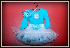 This beautiful tutu skirt is lovely hand made designed along with the flower headband. I added and cotton Long Sleeve Shirt size 12 months and I