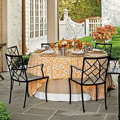 Sunny Summer Table Setting | Designer Jane Schwab goes for the gold, combining a sunny quilt with amber glassware at this summer affair. | SouthernLiving.com