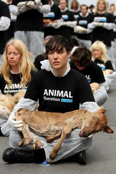 "Animal Liberation Victoria activists hold dead animals at Federation Square on October 1, 2013 in Melbourne, Australia. Over 200 activists gathered with the bodies of deceased animals to publicly grieve their deaths. Animal Liberation Victoria is against the treatment of animals as ""property"" and promotes a vegan lifestyle."