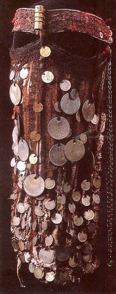Veil (burqha) from middle to lower Egypt.    The center tube called a arusat, represents the status of wearer. Some  veils have several.    Collection of Nelly Van den Abbeele