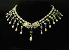 Center Rhinestone Clasp  The focal point of this necklace is an incredible, rhinestone encrusted clasp. The teardrop pearls and Swarovski crystal stunningly capture the sheer elegance of this piece. This necklace is now owned by Robin McGraw, wife of Dr. Phil McGraw.
