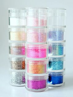These 'pill' stackers are great for edible baking glitter, sprinkles, etc. They come in different sizes, and are inexpensive.
