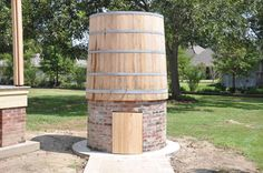 Cistern on a brick wall. Cisterns can be a good way to harvest rain for your garden or for emergency water when a storm knocks out the electricity.