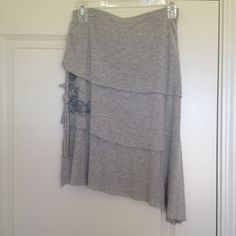 Billabong Lightweight Asymmetrical Grey Skirt Asymmetrical tiered grey skirt by Billabong. Amazingly soft feel. Perfect to just throw on and go. Design along right side (when worn). Rope accents on either side. Billabong Skirts Asymmetrical