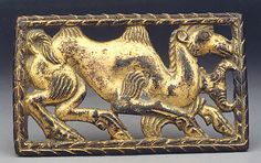 Plaque with Bactrian Camel  Date:     2nd–1st century B.C. Culture:     North China Medium:     Gilded bronze Dimensions:     H. 2 1/4 in. (5.7 cm); W. 3 1/2 in. (8.9 cm) Classification:     Metalwork