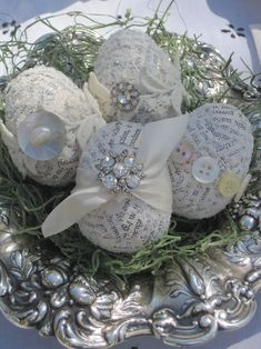 Cover plastic eggs with newspaper using modge podge then decorate with buttons, jewels, etc.