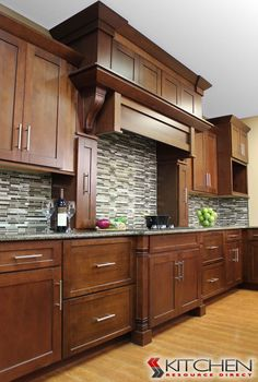 Masculine style kitchen with linear range hood; cabinets shown are Titusville RTA Shaker Maple Brandywine