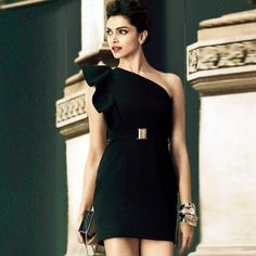 Deepika Padukone looks stunning in this one shoulder black dress. Shop the look now! #BollywoodFashion #CelebrityStyle #WomensFashion