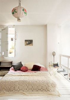 Guest bedroom: Soft coloured sheets with white/ivory crochet bedcover + dark wood dresser. Add some mixed throw cushions?