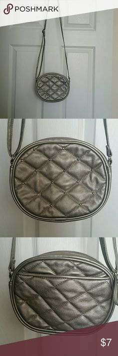 Silver Bueno Crossbody Purse Silver Crossbody Purse with Zipper closure, inside pocket with zipper, 2 open pockets, back slit pocket and silver studded front. Great condition Bueno  Bags Crossbody Bags