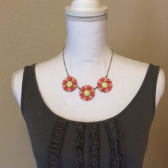 "Daisy Necklace Pink and orange daisies on this adorable statement necklace. Chain is adjustable up to 20.5"". Jewelry Necklaces"