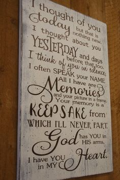 THIS ITEM SHIPS FREE!! Beautiful piece to display in memory of your loved one! This is a wood sign that measures 14 x 20. The background is