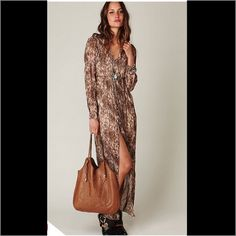 NWT Leopard Maxi Dress Button front, fitted elastic sleeves, long sleeves, leopard print. Could be worn open as a coat or closed as a dress. Gorgeous. No trades. Generous discount with bundle. Free People Dresses Maxi