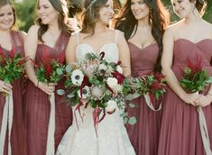 Jenny Yoo Bridesmaids, the long soft tulle Annabelle Dress in a shade of Burgundy called Cinnamon Rose features a shirred strapless bodice with a sweetheart neckline. The floor length A-line skirt features convertible panels that can be used to create multiple customized looks! Includes a detachable sash to tie around the waist to create definition. Available in all Soft Tulle colors. Photography by Sophie Epton.