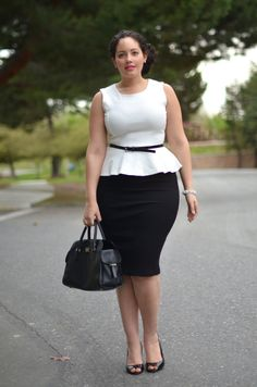 This is a good style for us curvy women - the skirt length is just right, and peplums give the effect of an hour-glass figure and a longer line. The cute belt here also helps define a waist without being too snug to indicate that this gal is (as is 80% of the world) short-waisted.