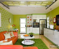 The custom cabinets supply lots of storage for electronics, games, and the like. Cool '60s-inspired light fixtures offer another fun accent and help to bounce brightness around the room—especially helpful when the garage door is closed. The long countertop doubles as a serving space during gatherings.