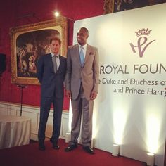 Prince Harry stands on tiptoes but still fails to measure up to 7ft 2in @officialmutombo  at #Coachcore graduation