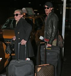 Get us home: The two famous actors wait for a cab outside JFK