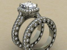 Vintage inspired engagement ring with matching wedding band.  The center stone is a 2.0 ct princess cut.