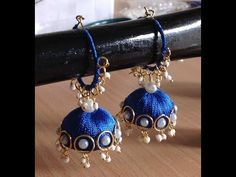 This video shows how to make designer silk thread handmade jhumka hoop earrings using pearls and loreals mainly. Silk Thread Earrings Designs, Silk Thread Bangles Design, Silk Thread Necklace, Silk Bangles, Thread Jewellery, Handmade Jewellery, Beaded Jewellery, Jewellery Making, Bridal Jewelry