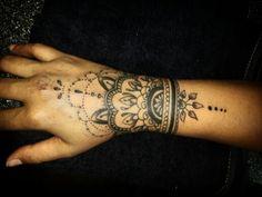 Mendi hand tattoo