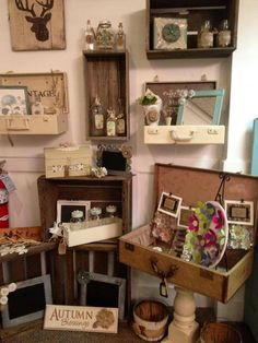 It looks like a store display but I like some of the ideas - especially vintage suitcase