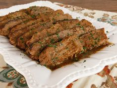 Savory Slow Cooker Brisket - Simple Brisket Recipe with Onion, Garlic and Spices Made in the Crock Pot. Easy, Tender, Delicious. Kosher for Passover