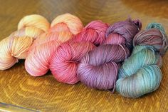 Gorgeous yarns from Tanis Fibre Arts. Believe it or not, these yarns were all dyed orange, then overdyed.