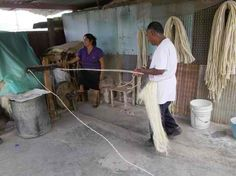 Making rope from henequen fibers.