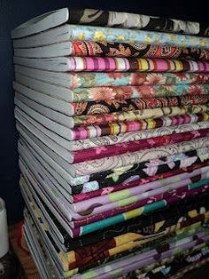 fun idea to decorate notebooks with fabric - perhaps for NEXT YEARs plan book -- love this idea!!