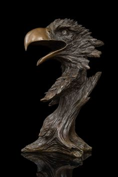 Another great eagle head bronze bust that we find to attractive. This one features a slightly darker natural brown oxidation color with hand polished highlights throughout the entire bust. Fine details in the face and feathers including the unique wooden base that the head rest on look amazing and unique. - Size (cm) H 34 * L 20 * W 23.5 - 17.64 lbs - Lost wax bronze cast wildlife eagle statue - Bronze pedestal base