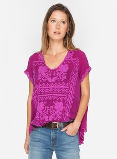 Delamo Flare Blouse The Johnny Was DELAMO FLAIR BLOUSE features a tonal embroidery design that combines geometric and floral elements accented by scalloped trim along the cap sleeves and high/low hemline. Pair this feminine take on the staple tee with boyfriend jeans and sandals for an easy-going boho look!  - Rayon Georgette - Scoop Neckline, Cap Sleeves, High/Low Hemline - Signature Embroidery - Care Instructions: Machine Wash Cold, Tumble Dry Low - Model's Height is 5'10