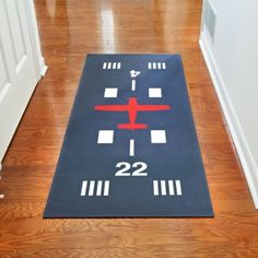 Add a touch of aviation to your home with our Runway Hallway Runner Mat. An airplane silhouette, runway markings and runway numbers are printed onto the gray polyester surface. Mats features skid resistant backing that will not curl or crack, machine wash