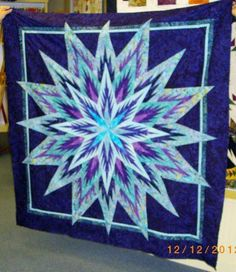 Feathered Star ~ Quiltworx.com, made by Mary Calderon