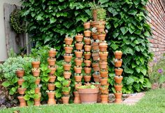 Stacks of Pots - stack them on rebar, then cuts lengths of an old hose for spacers