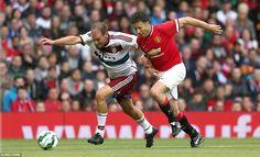 Alexander Zickler (left) races past United defender Ronny Johnson before equalising for Ba...