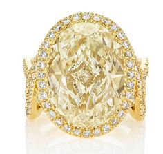 Warm, rich and full of energy, the Aella High Jewellery Ring showcases the creativity at the heart of De Beers, with criss-crossing rows of white micropavé diamonds surrounding a 5 carat yellow oval-cut diamond. High Jewelry, Jewelry Box, Jewellery, Yellow Diamond Rings, Engagement Rings, Creativity, Diamonds, Warm, De Beers