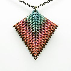 Which is your favorite shape?Slide 1 or slide 2? (If you're like me, you just had an eye exam flash in your brain.) These necklaces are made with the same color combinations just with a different design. Come see us today at the Woodbury Arts Center. We'd love to see you. #colorsplash #handmade #handsandhustle #beads #beadwork #pursuepretty #creativityforlife #creativelifehappylife #necklaces #sewing #southernmakers #shop615 #shoplocal #peyote #weaving #stitching #makersmovement…